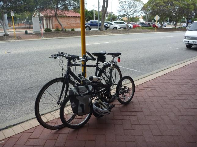 A parking sign makes a good bike rack